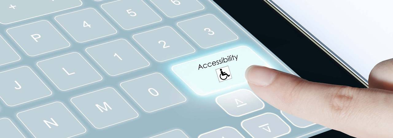 finger pointing to digital accessibility button