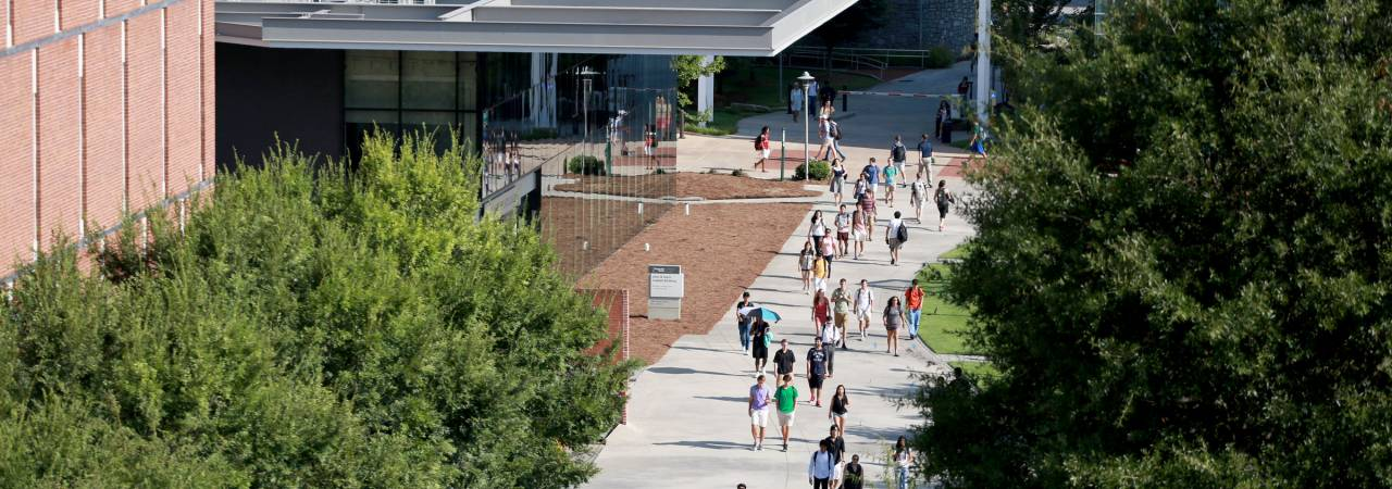 image of students walking around college campus