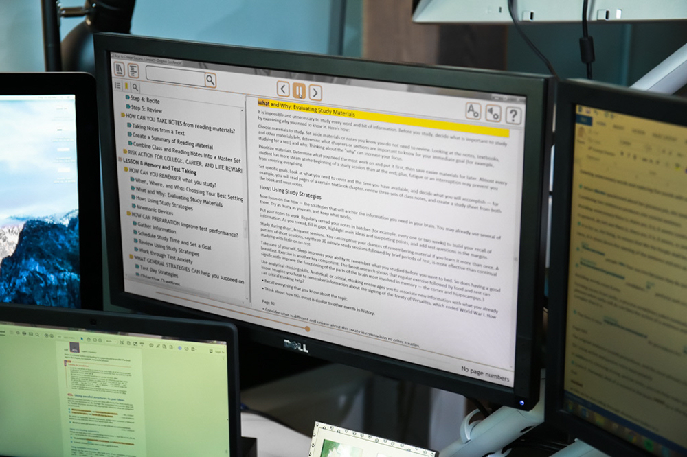 A computer monitor showing Etext.
